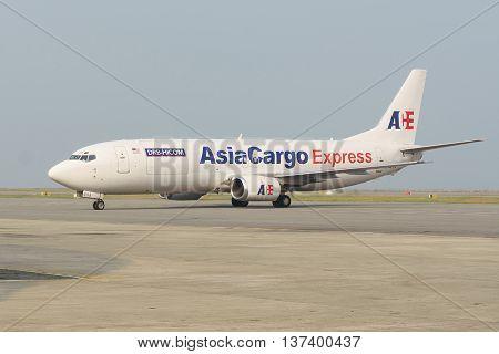 Kota Kinabalu Sabah Malaysia - Apr 9 2016 : AsiaCargo Express Boeing737-400F cargo aircarft with maximum cargo capacity 18.5 tan pictured at Kota Kinabalu International Airport on Apr 9 2016.