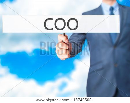 Coo - Business Man Showing Sign
