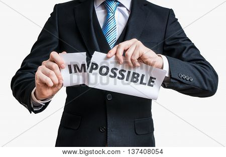 Possibility Concept. Man Is Tearing Paper With Impossible Word T