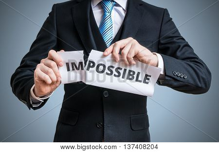 Possibility Concept. Businessman Is Tearing Paper With Impossibl