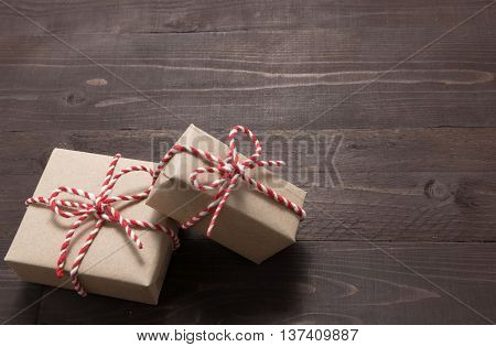 Ift Boxes Are On The Wooden Background With Empty Space
