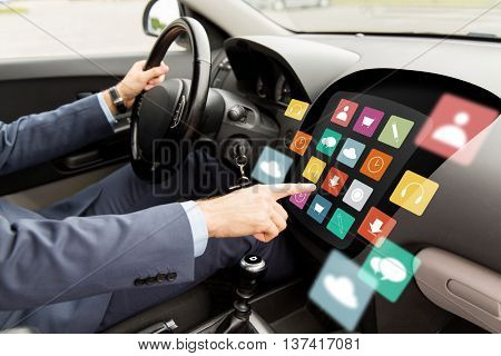 transport, modern technology, multimedia, business and people concept - close up of man driving car with menu icons on board computer screen