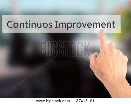 Continuos Improvement - Hand Pressing A Button On Blurred Background Concept On Visual Screen.