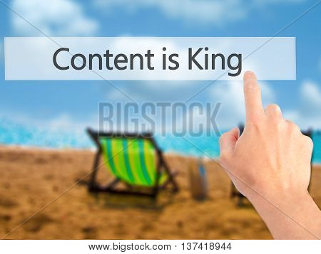 Content Is King - Hand Pressing A Button On Blurred Background Concept On Visual Screen.
