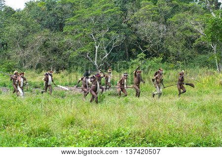 Warriors Of A Papuan Tribe In Traditional Clothes