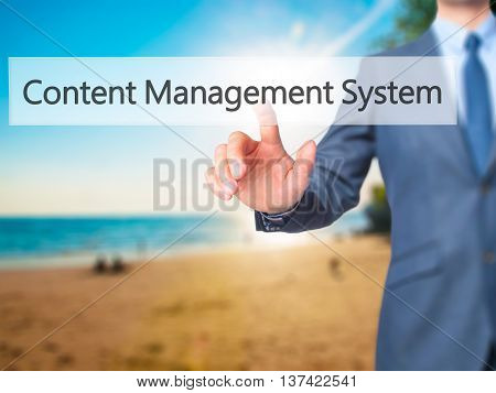Content Management System - Businessman Hand Touch  Button On Virtual  Screen Interface