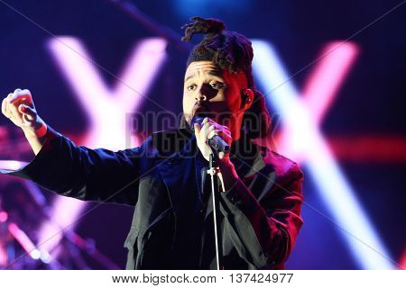 HOLLYWOOD, CA-OCT 24: The Weeknd performs onstage during CBS RADIOs third annual We Can Survive, presented by Chrysler, at the Hollywood Bowl on October 24, 2015 in Hollywood, California.