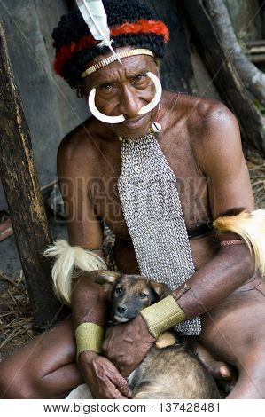 PAPUA PROVINCE INDONESIA -DEC 28 The man of a Papuan tribe in traditional clothes and coloring in New Guinea Island Indonesia on December 28 2010