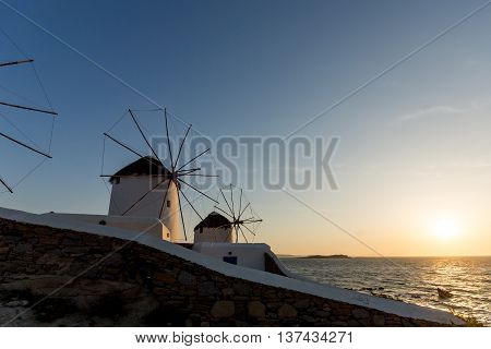 Sunset view of White windmills on the island of Mykonos, Cyclades, Greece