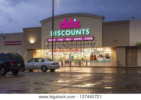 DALLAS TX USA - APR 17 2016: Exterior of the dd's discounts fashion store illuminated at night. Texas United States