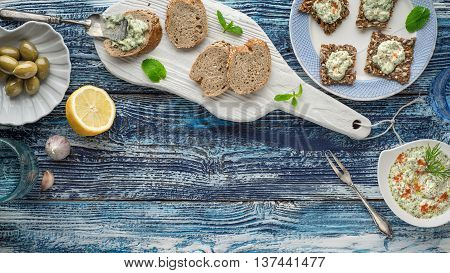 Bread with tzatziki on the blue wooden table with accessorize horizontal
