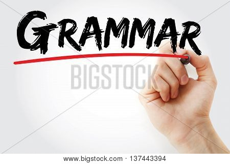 Hand writing Grammar with marker education concept background