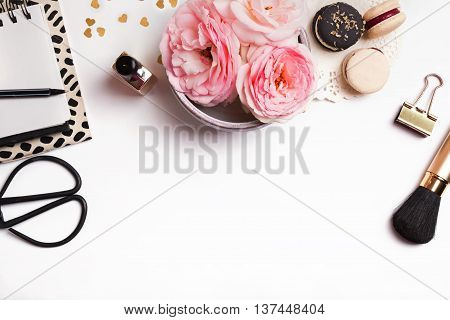 Beautiful pink flowers french macarons notepad and other cute feminine stuff on white background top view poster