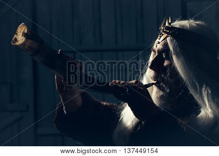 Bearded Man With Animal Horn