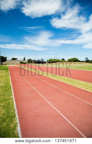 Front view of empty running track on sunny time