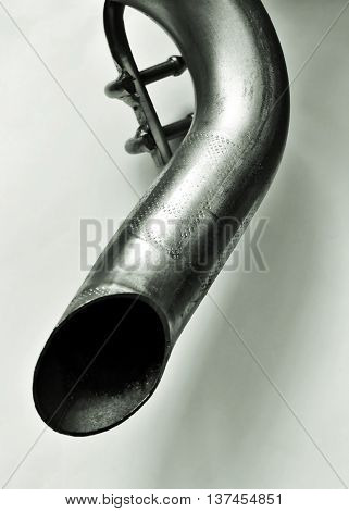Exhaust pipe of a car on a white background