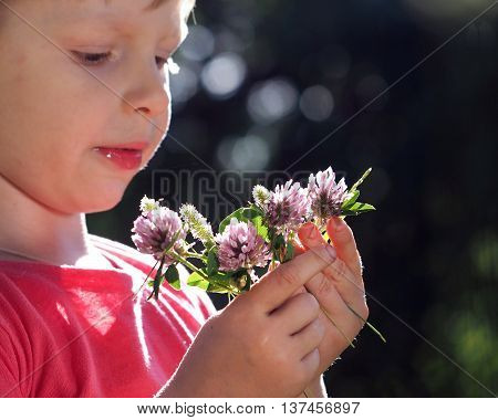 Cheerful Grimy Kid With A Bouquet Of Flowers