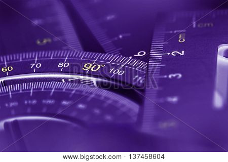 extremely selective focus a part of the silver precision measurement tool purple glowing luminescence color