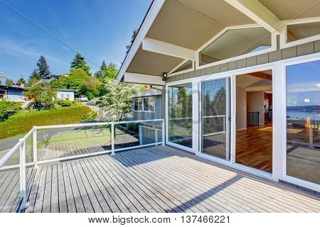 Balcony House Exterior With Glass Railings And Nice View.