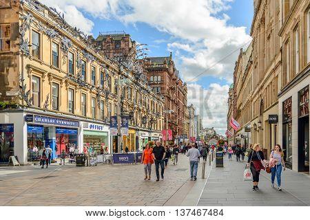 GLASGOW SCOTLAND - JULY 05 2016: Summer afternoon in the pedestrian retail area Buchanan Street in Glasgow Scotland.