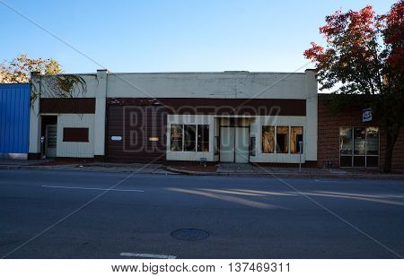 JOLIET, ILLINOIS / UNITED STATES - NOVEMBER 1, 2015: A vacant building in downtown Joliet, Illinois.