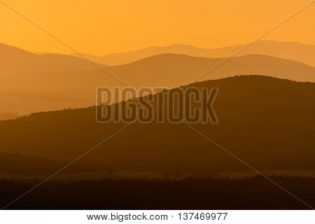 Toskana hills sundown with orange colored light
