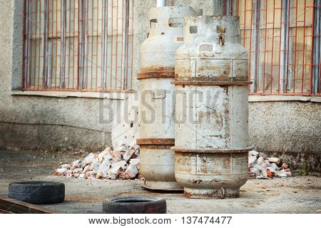 Old metal containers on window background outside