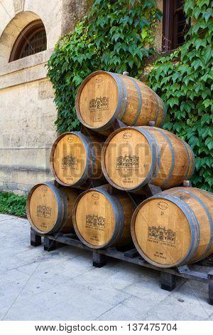 Calistoga California - May 10 : Wine barrels stacked outside of the Chateau Montelena May 10 2015 Calistoga California.