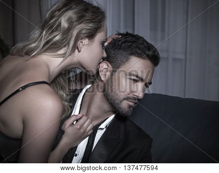 Macho man reject sexy young blonde woman at night poster