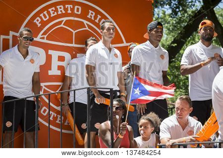 NEW YORK - JUNE 12 2016: Members of the Puerto Rico Football Club celebrate on a float during the 59th annual National Puerto Rican Day Parade on 5th Avenue in New York City on June 12 2016.