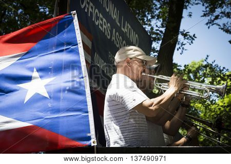 NEW YORK - JUNE 12 2016: Musicians perform from on top of a float during the 59th annual National Puerto Rican Day Parade on 5th Avenue in New York City on June 12 2016.