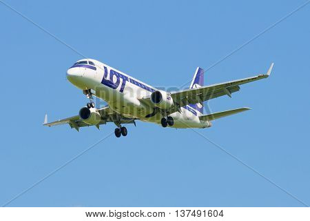 SAINT PETERSBURG, RUSSIA - JUNE 29, 2015: The Embraer E-170 (SP-LIN) LOT Polish Airlines is landing in Pulkovo airport