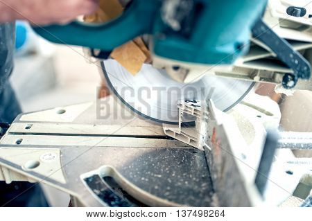 Worker Or Handyman Cutting Pvc Profile With Circular Saw,sliding