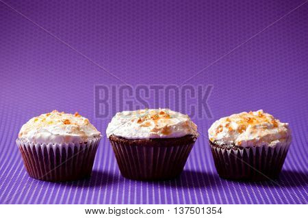Three Chocolate Velvet Cupcakes With Vanilla Icecream Topping Is
