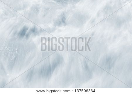An abstract long exposure of whitewater resulting from breaking ocean waves.