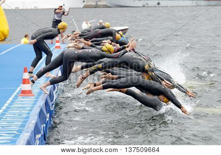 STOCKHOLM - JUL 02 2016: The female competitors jump into the water after the start signal in the Women's ITU World Triathlon series event July 02 2016 in Stockholm Sweden