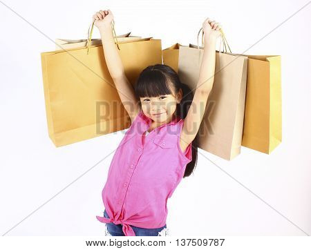 Little girl with shopping bags, isolated on white.