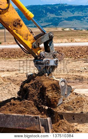 Heavy Duty Construction Excavator Loading Sand Into A Dumper Tru