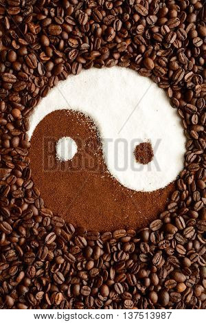 Yin yang symbol made out of coffee beans