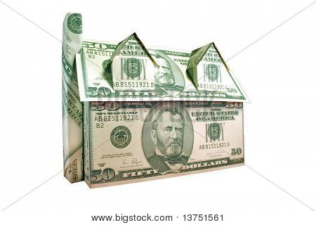 A house of fifty dollar bills isolated against white with clipping path