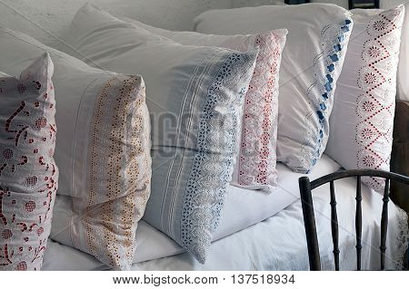 Romanian pillows traditional embroidered. Farmhouse interior the Banat region (part of Transylvania) Romania.