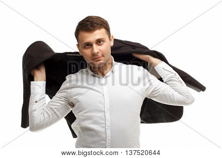 Portrait of handsome businessman wearing white shirt threw his jacket over his shoulder isolated on white