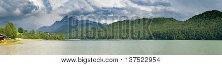 Forggensee Mountain Lake in the south of Bavaria, Germany and the mountains on horizon