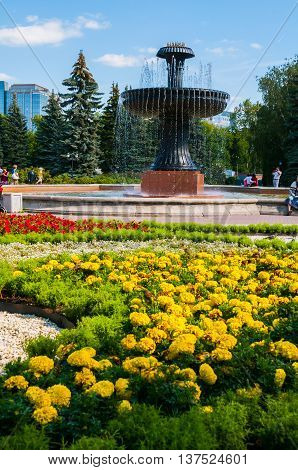 YEKATERINBURG RUSSIA - AUGUST 24 2013. Landscaping park view - fountain in the city arboretum exhibition in summer sunny day in Yekaterinburg Russia