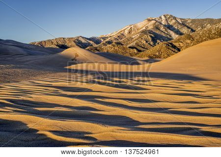 sand dunes patterns and texture at sunset - Great Sand Dunes National Park in Colorado
