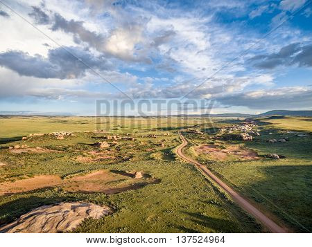 Ranch road over prairie at Sand Creek National Natural Landmark, Albany County, Wyoming -aerial view towards Colorado