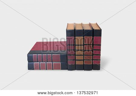 Red books covers with serial numbers. Retro book collection ten volumes, textured leather. White background