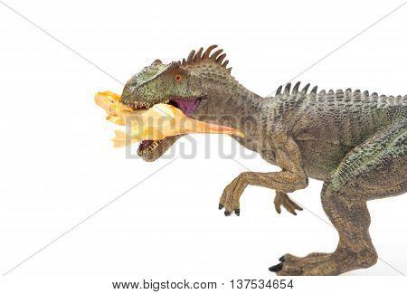 grey allosaurus toy catching a smaller disonaur on white background