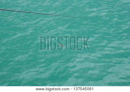 fishhook on green sea surface in Thailand