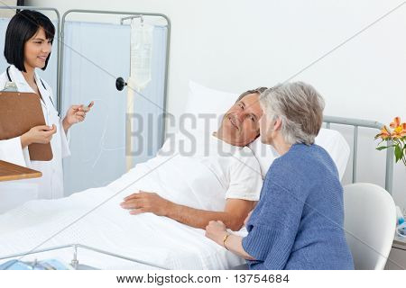 Nurse talking with a couple in a hospital